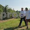 AMANDA SABGA/Staff photo <br /> <br /> New Hampshire Gov. Chris Sununu walks with Sunnycrest farm owner Dan Hicks as he kicks off apple season at Sunnycrest Farm in Londonderry. <br /> <br /> 9/6/18