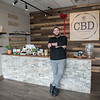 AMANDA SABGA/Staff photo<br /> <br /> Josh Gragg poses at his store, CBD American Shaman, that recently opened in Londonderry.<br /> <br /> <br /> 4/5/19