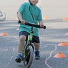 TIM JEAN/Staff photo<br /> <br /> <br /> Westin McLean, 3, of Londonderry, makes his way thru a safety bicycle corse during a bike rodeo held at the middle School in Londonderry, NH. The event promoted bike safety and had inspections, helmet fittings and various safety stations for the kids. The event was organized by the Londonderry Police Department and the Kiwanis Club of Greater Derry.  7/27/19