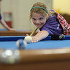 TIM JEAN/Staff photo<br /> <br /> Jillian Hull, 8, of Derry, takes aim at the ball while playing a game of billiards during the summer programs at the Boys and Girls Club of Greater Derry.   8/1/19