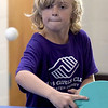 TIM JEAN/Staff photo<br /> <br /> Jonny Porto, 8, of Derry, looks to return a serve while playing a game of table tennis during the summer programs at the Boys and Girls Club of Greater Derry.   8/1/19