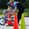 TIM JEAN/Staff photo<br /> <br /> <br /> Jariana Hernandez, 3, of Londonderry, makes her way thru a safety bicycle corse with help from Katie Smigelski, Londonderry Police Officer, during a bike rodeo held at the middle School in Londonderry, NH. The event promoted bike safety and had inspections, helmet fittings and various safety stations for the kids. The event was organized by the Londonderry Police Department and the Kiwanis Club of Greater Derry.  7/27/19