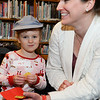 CARL RUSSO/Staff photo. Lily Theroux, 3 shares a Christmas cookie with her mother Jen. They live in Derry. Taylor Library in East Derry hosted its annual Polar Express story time Thursday night. 12/12/2019