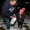 CARL RUSSO/Staff photo. Amy Famiglietti helps her daughter Addison, 2, pick up her candy canes. <br /> <br /> It is rumored that Santa is about to hide hundreds of candy canes around the Y! Grab your flashlight and join us as we search for hidden candy canes. The Londonderry YMCA held its second Candy Cane Hunt Friday night.  2/13/2019