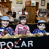 CARL RUSSO/Staff photo. The DiRico family of Derry, from left, Shayla,10; Aubree, 7 and David, 4 ride the Polar Express together. Taylor Library in East Derry hosted its annual Polar Express story time Thursday night. 12/12/2019