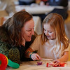 MIKE SPRINGER/Staff photo<br /> Brenda O'Brien and her daughter Nevina, 6, enjoy decorating cookies together during the Frost Festival on Sunday at the Alexander Carr Park Lodge in Derry.<br /> 2/10/2019