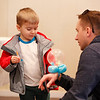 MIKE SPRINGER/Staff photo<br /> Three-year-old Landon Rassbach and his father, Charles, examine the balloon creation Landon had just received during the Frost Festival on Sunday at the Alexander Carr Park Lodge in Derry.<br /> 2/10/2019