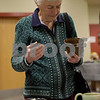 TIM JEAN/Staff photo<br /> <br /> Margie Ives, of Derry, looks over a bowl before enjoying some soup, during the 14th annual Potter's Bowl fundraiser to benefit Community Caregivers of Greater Derry.    2/2/19
