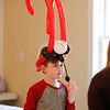 MIKE SPRINGER/Staff photo<br /> Ten-year-old Aiden Golden wears a whimsical balloon hat custom-made for him during the Frost Festival on Sunday at the Alexander Carr Park Lodge in Derry.<br /> 2/10/2019