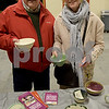 TIM JEAN/Staff photo<br /> <br /> David Trovato, left, and Michelle Bradley, both of Windham, pick out bowls before enjoying some soup, during the 14th annual Potter's Bowl fundraiser to benefit Community Caregivers of Greater Derry.    2/2/19