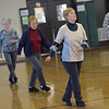 TIM JEAN/Staff photo<br /> <br /> Derry senior citizens enjoy line dancing at Veterans Memorial Hall in Derry.  1/11/19