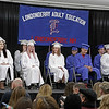 MIKE SPRINGER/Staff photo<br /> Graduating seniors sit on stage during the Londonderry Adult Education January 2019 commencement ceremony Wednesday evening at Londonderry High School. Visible onstage are, from left, Allie Pelletier, Vanessa Ventura (partially hidden), Jillian Mellinger, Kyle Toxey (mostly hidden), Emily McCarthy, Austin Socci, William Luzunari, Kyler Renaud and Krystal Diefenbach. Also graduating were Taylor Williams, Victoria Holmes and Ashley McClelland.<br /> 1/16/2019