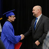 MIKE SPRINGER/Staff photo<br /> Graduate Austin Socci receives a congratulatory handshake from Superintendent Scott Laliberte after receiving his diploma during the Londonderry Adult Education January 2019 commencement ceremony Wednesday evening at Londonderry High School.<br /> 1/16/2019