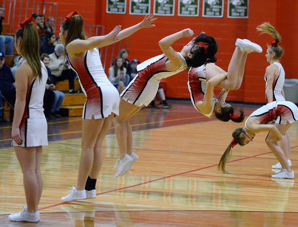 CARL RUSSO/Staff photo. Members of the Pinkerton Academy Astros cheerleading team perform back flips for the crowd during Friday night's (1/4/19) girls' basketball game. Pinkerton Academy defeated Salem 65-35 in girls basketball action. 1/4/2019
