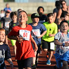 CARL RUSSO/Staff photo Evan Burgenhagen, 7 of Londonderry #60 races to the finish line. <br /> <br /> The 45th year for  the Greater Derry Track Club's annual summer Fun Runs for kids of all ages. The event is held at the Londonderry High School track. 7/01/2019