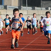CARL RUSSO/Staff photo Cody Hunt, 3, front, of Londonderry competes in his race. <br /> <br /> The 45th year for  the Greater Derry Track Club's annual summer Fun Runs for kids of all ages. The event is held at the Londonderry High School track. 7/01/2019