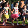 CARL RUSSO/Staff photo Finishing their race hand-in-hand are, from left, Alise Scott, Olivia Muse and Emiley Rose, all five years-old and from Derry. <br /> <br /> The 45th year for  the Greater Derry Track Club's annual summer Fun Runs for kids of all ages. The event is held at the Londonderry High School track. 7/01/2019