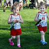 CARL RUSSO/Staff photo Two-year-old twins, Emma, left, and Isla Longo of Londonderry receive their ribbons after the race. <br /> <br /> The 45th year for  the Greater Derry Track Club's annual summer Fun Runs for kids of all ages. The event is held at the Londonderry High School track. 7/01/2019