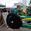 TIM JEAN/Staff photo<br /> <br /> Volunteer Dlyan Wetherbee walks inside a balloon tractor to promote the Derry Homegrown Farm and Artisan Market in downtown Derry, NH.    6/5/19