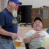MIKE SPRINGER/Staff photo<br /> U.S. Army Vietnam War veteran Tony Bruno, right, jokes with server Charlie Crompton of the Derry Village Rotary Club during the Veterans Recognition Dinner Thursday at the Boys and Girls Club of Derry.<br /> 5/30/2019