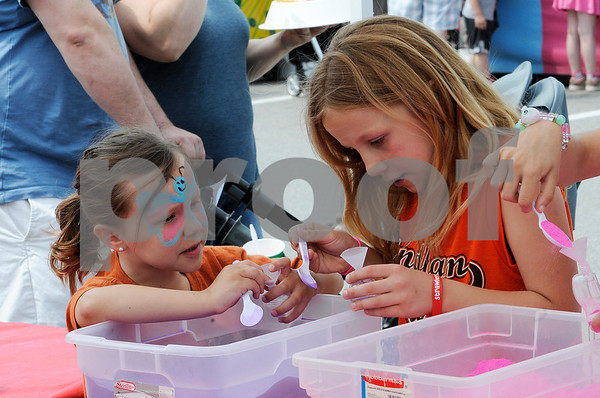 TIM JEAN/Staff photo<br /> <br /> Sisters Lilah Teyssedou, 6, of Windham, and Jocelyn, 9, make sand art during the 36th Annual Strawberry Festival, and Windham's Nutfield 300th celebration.      6/1/19