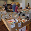 TIM JEAN/Staff photo<br /> <br /> People browse over books from the Friends of the Library of Windham (F.L.O.W.) annual book sale to benefit the Nesmith Library during the 36th Annual Strawberry Festival, and Windham's Nutfield 300th celebration.      6/1/19
