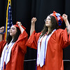 CARL RUSSO/Staff photo Pinkerton graduates Ashlee Weatherbee, left and Emma Groenewal sign the National Anthem to open the ceremony. <br /> <br />  Over 700 Pinkerton Academy seniors graduated Monday afternoon from the Southern New Hampshire University Arena in Manchester.  6/10/2019