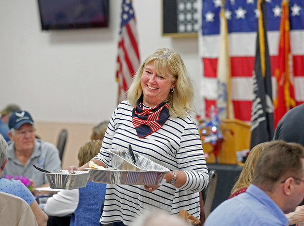 MIKE SPRINGER/Staff photo<br /> Deb Bulkley serves food with a smile Thursday during the Veterans Recognition Dinner sponsored by the Rotary Clubs of Derry at the Boys and Girls Club of Derry.<br /> 5/30/2019