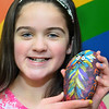 CARL RUSSO/staff photo DERRY NEWS: Mikayla Henrick, 11 of Derry shows her colorful Kindness Rock. First Parish Church is doing a Kindness Rocks project, where small rocks are painted with uplifting, positive messages and placed around the community. <br /> Kindness Rocks is a national program that many communities are doing. 3/2/2019