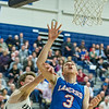 AMANDA SABGA/Staff photo<br /> <br /> Londonderry's Ethan May (3) is fouled by Exeter's Kevin Henry (22) during a D1 semifinal game between Londonderry High School and Exeter High School at the University of New Hampshire. Londonderry lost to Exeter 62-51.<br /> <br /> 3/13/19