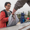 AMANDA SABGA/Staff photo<br /> <br /> Ben Quimpo, 10, of Derry has his fish measured for length at the Annual Fishing Derby at Hood Park during the Downtown Derby Day event in Derry, NH.<br /> <br /> 5/4/19