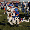 TIM JEAN/Staff photo <br /> <br /> Salem's Riley Mulvey is caught from behind by Londonderry's Kyle Proulx during the New Hampshire Division 1 semifinal football game. Salem lost 35-14.     11/16/19