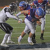 MIKE SPRINGER/Staff photo<br /> Londonderry runningback Tyler Kayo carries the ball into the endzone to score the Lancers' third touchdown during Division 1 state football championships Sunday against Exeter at the University of New Hampshire in Durham.<br /> 11/24/2019