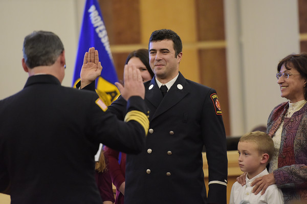 TIM JEAN/Staff photo <br /> <br /> Derry Fire Assistant Chief James Richardson, left, administers the Oath of Office to Lt. Thomas Beaumont, during a Promotional Ceremony at the Derry Municipal Center.  11/21/19