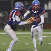 MIKE SPRINGER/Staff photo<br /> Londonderry quarterback Jake McEachern, left, hands the ball to Alexander Tsetsilas during Division 1 state football championships Sunday against Exeter at the University of New Hampshire in Durham.<br /> 11/24/2019
