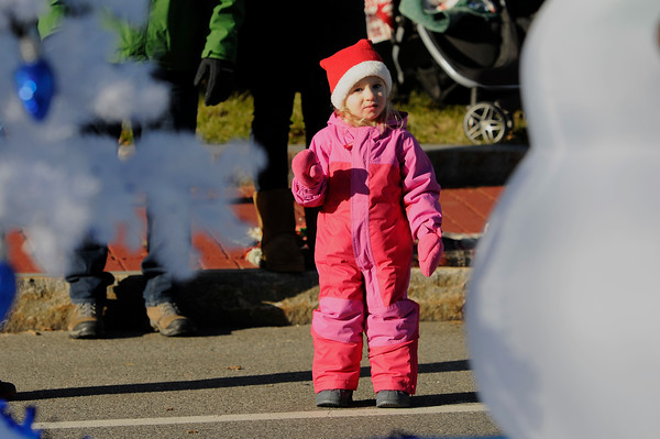 TIM JEAN/Staff photo <br /> <br /> Elizabeth Task, 3, of Londonderry waves towards a snowman on a float during the Annual Nutfield Holiday Parade in Derry, NH.     11/30/19