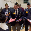 TIM JEAN/Staff photo <br /> <br /> Jim Gallotto, center, of Windham, along with his fellow veterans receive thanks you cards from students during the annual Veterans Day assembly at Golden Brook Elementary School in Windham.     11/8/19