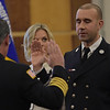 TIM JEAN/Staff photo <br /> <br /> Derry Fire Assistant Chief James Richardson, left, administers the Oath of Office to Capt. Ryan Bump, during a Promotional Ceremony at the Derry Municipal Center.  11/21/19