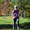 TIM JEAN/Staff photo<br /> <br /> June Gray, of Manchester, makes her way through the apple orchard during North Londonderry School first annual Fall Fun Run held at Mack's Apples. 11/2/19