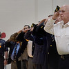 TIM JEAN/Staff photo <br /> <br /> Windham Assistant Fire Chief Ed Morgan, right, salutes with his fellow veterans for the Pledge of Allegiance during the annual Veterans Day assembly at Golden Brook Elementary School in Windham.     11/8/19