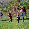 TIM JEAN/Staff photo<br /> <br /> Carrie Barry, right, of Londonderry, runs along side of her son Tyler, left, and his friend Talon Smith, both 7, as they make their way through the apple orchard during North Londonderry School first annual Fall Fun Run held at Mack's Apples. 11/2/19
