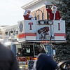 TIM JEAN/Staff photo <br /> <br /> Mrs. Claus and Santa wave to the crowds from the top of a Derry Fire Truck during the Annual Nutfield Holiday Parade in Derry, NH.     11/30/19