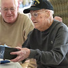 TIM JEAN/Staff photo <br /> <br /> John Powers, 101, of Londonderry, a WWII, Army Veteran in the 77th Infantry Division receives a special gift being the oldest veteran during a Veterans Breakfast at Londonderry High School.    11/9/19