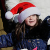 TIM JEAN/Staff photo <br /> <br /> Emma Hoffman, 6, of Derry, points towards one of the festive floats during the Annual Nutfield Holiday Parade in Derry, NH.     11/30/19