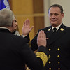 TIM JEAN/Staff photo <br /> <br /> Derry Fire Chief Michael J. Gagnon, left, administers the Oath of Office to Assistant Chief James Richardson during a Promotional Ceremony at the Derry Municipal Center.  11/21/19