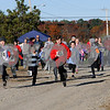 TIM JEAN/Staff photo<br /> <br /> Young and old runners make their way through the apple orchard during North Londonderry School first annual Fall Fun Run held at Mack's Apples. 11/2/19