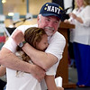 TIM JEAN/Staff photo <br /> <br /> US Navy Veteran Charlie Sullivan, of Londonderry, hugs his granddaughter Sammie Sullivan, 12, after she read a poem about him during a Veterans Breakfast at Londonderry High School.    11/9/19