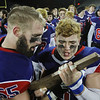 MIKE SPRINGER/Staff photo<br /> Justin Miller, left, and Tyler Kayo of the Londonderry Lancers take a look at the state Division 1 championship trophy after their victory Sunday over Exeter at the University of New Hampshire in Durham.<br /> 11/24/2019