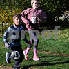 TIM JEAN/Staff photo<br /> <br /> Benn Barry, 7, left, and Annabelle Ackerson, 10, make their way through the apple orchard during North Londonderry School first annual Fall Fun Run held at Mack's Apples. 11/2/19