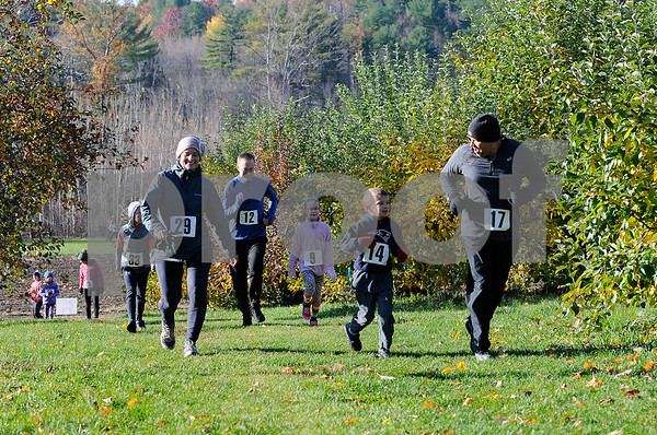 TIM JEAN/Staff photo<br /> <br /> Runners make their way through the apple orchard during North Londonderry School first annual Fall Fun Run held at Mack's Apples. 11/2/19